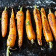 Stock Photo: Whole roasted carrots with tails