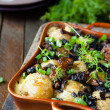Baby potatoes baked with mushrooms — Stock Photo