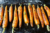 Whole roasted carrots with tails — Stock Photo