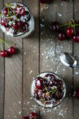 Two dessert with cherries and vanilla cream and chocolate — Stock Photo