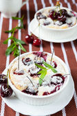 Cherry pudding in a baking dish — Stock Photo