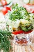 Potato salad in a transparent bowl — Stock Photo