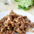 Stock Photo: Roasted chanterelle mushrooms