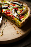 Vegetable quiche with sprats — Stock Photo