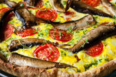 Pie with vegetables and sprats — Stock Photo