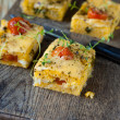 Squares of polenta with cheese — Stock Photo