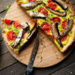 Stock Photo: Vegetable quiche with sprats