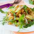 Fried potatoes with arugula — Stock Photo #27188909
