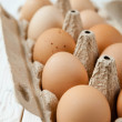 Farm fresh eggs in a cardboard tray — Stock Photo