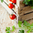 Harvest vegetables in a wooden crate — Stock Photo