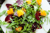 Salad with arugula and orange — Stock Photo