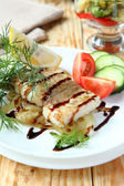 Fish with sauce and vegetables — Stock Photo