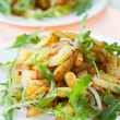 Slices of roasted potatoes and arugula — Foto Stock