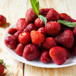 Stock Photo: Big plate of strawberries without tails