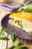Large piece of the pie with spring onions and eggs — Stock Photo