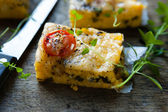 Polenta with tomato and cheese — Stock Photo