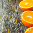 Wooden board and half an orange — Stock Photo