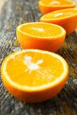 Wooden cutting board and half an orange — Fotografia Stock