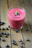 Blueberry smoothie and blueberries — Stock Photo
