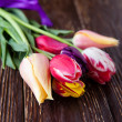 Fresh tulips on brown boards — Stock Photo #29862873