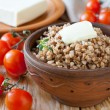 Stock Photo: Nutritious buckwheat porridge with butter