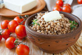 Nutritious buckwheat porridge with butter — Stock Photo