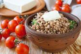 Nutritious buckwheat porridge with butter — Stock Photo