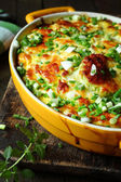 Casserole with cheese on a rural kitchen — Stock Photo