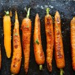 Baked carrots on a baking sheet — Stock Photo