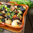 Roasted potato with mushrooms and herbs — Stock Photo
