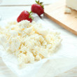 Cottage cheese on a wooden table — Stock Photo