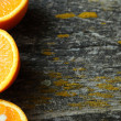 Orange halves on an old table — Stock Photo
