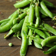Fresh pea pods on the table — Stock Photo