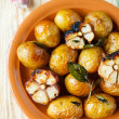 Potatoes baked in their skins with garlic — Stock Photo