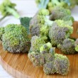 Broccoli florets on a cutting board — Stock Photo
