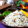 Boiled white and wild rice on a plate — Stock Photo