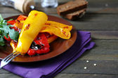 Chunks of roasted peppers on a plate — Stock Photo