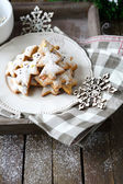 Christmas gingerbread cookies and snowflake — Stock Photo