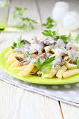 Penne with grilled mushrooms in sour cream — Stock Photo