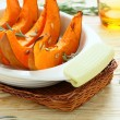 Slices of baked pumpkin in baking dish — Stock Photo #31599967