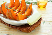 Slices of baked pumpkin in baking dish — Stock Photo