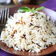 Plate full of cooked rice, white and wild — Stock Photo
