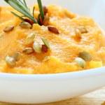 Fresh pumpkin soup in a white bowl — Stock Photo #31890801