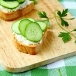 Bruschetta with goat cheese and cucumber slices — Stok fotoğraf