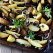 Stock Photo: Roasted potato wedges with mushrooms