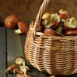 Freshly picked mushrooms in a wicker basket — Stock Photo