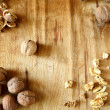 Walnuts on the old board, peel and core — Stock Photo