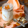 Fresh yogurt with pieces of apricot — Stock Photo