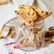 Cookies with nuts and dried fruit - biscotti in a jar — Stock Photo #33280421