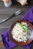 Boiled long grain rice on a ceramic plate — Stock Photo